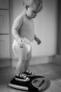 loose weight - kid weighing itself